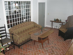 Sunroom herringbone brick tile floor