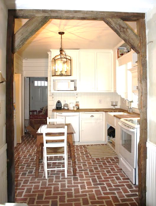 kitchen with brick floor - photo #16