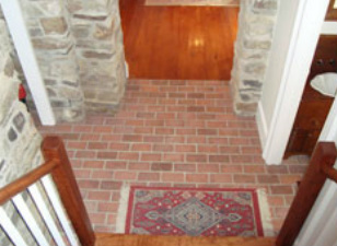Picture brick floor tile in entry with stone walls