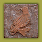 Bird embossed on brick tile