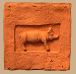 Brick embossed with pig