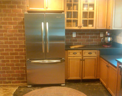 Thin brick kitchen wall and backsplash tile