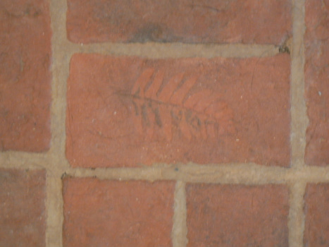 Custom thin brick floor tile with plant imprint