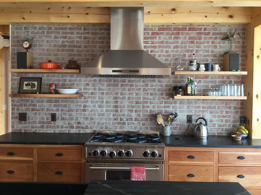 white washed brick kitchen backsplash