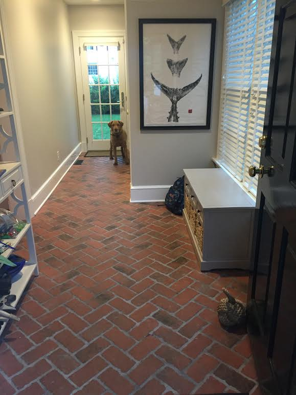 Picture mudroom antique look tumbled brick tile floor